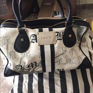 L.A.M.B purse